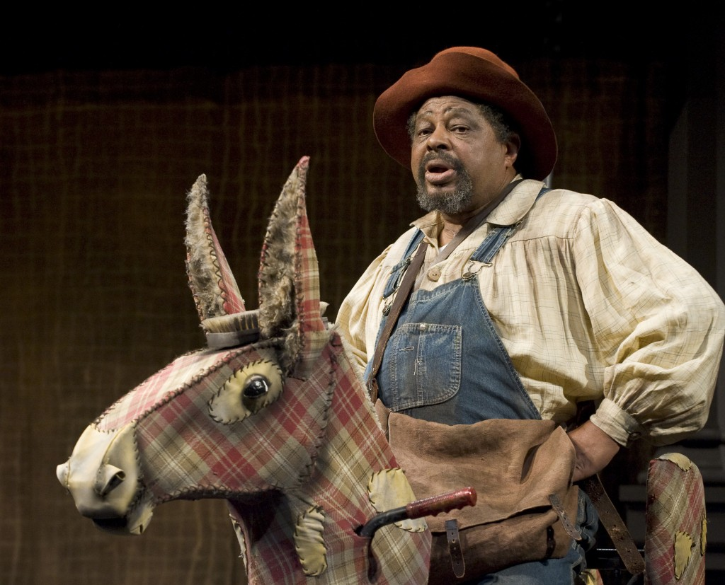 "Josiah Phillips as Sancha Panza, with his devoted donkey, in ""Don Quixote."" Photo: David Cooper/Oregon Shakespeare Festival/2009"