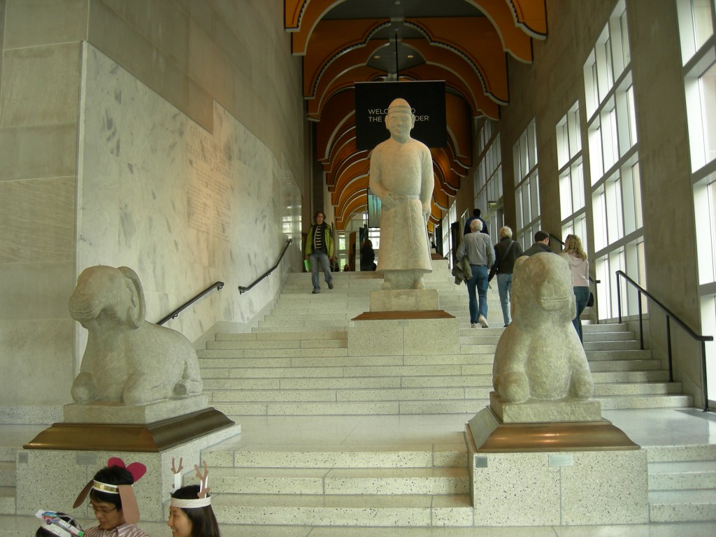 "The ""Art Ladder,"" the main staircase of the original Robert Venturi portion of the Seattle Art Museum. The visible statues are Chinese funerary statues: two rams and a civilian guardian. May 5, 2007. Photo by Joe Mabel/Wikimedia Commons"