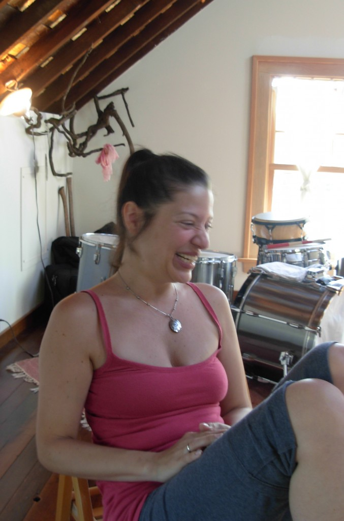 Christine Calfas in her attic studio, preparing to WHOOP.