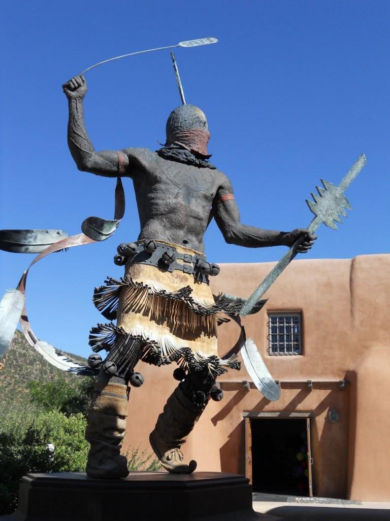"""Apache Mountain Spirit Dancer,"" Craig Dan Goseyun, San Carlos Apache. Museum Hill Plaza, Santa Fe; bronze; 1995."