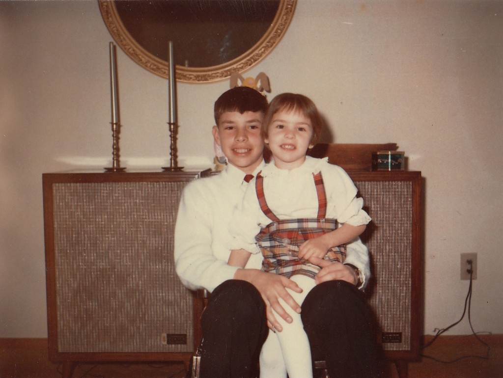 Looks like we were dressed for Easter. Remember when we could still fit in the miniature rocking chair?
