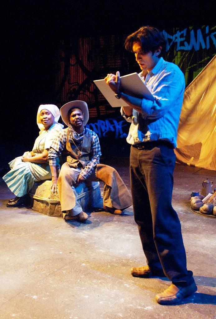 Juan José (René Millán) adds to his history book after meeting Viola and Ben Pettus (Kimberly Scott, Rodney Gardiner). Photo by Jenny Graham.