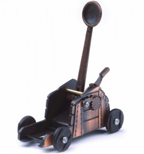 A cheap die-cast Roman catapult with a built-in pencil sharpener costs only a few bucks and can be found at any tourist trap in London, but it earned Mrs. Scatter enormous clout with her catapult-loving son.