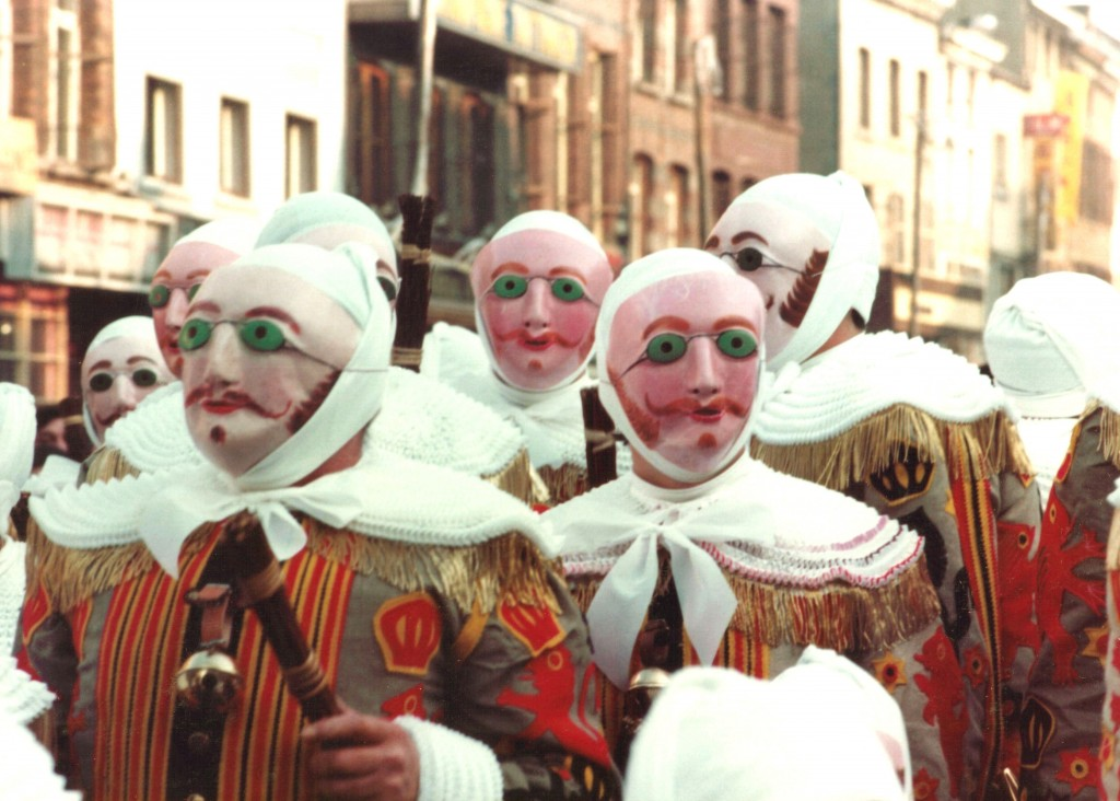 In Binche, Belgium, Les Gilles, an all-male group of about 1,000 Mardi Gras revelers, wearing their masks; 1982. Photo: Marie-Claire/Wikimedia Commons.
