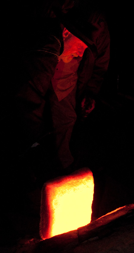Nils Lou, longtime keeper of the East Creek kiln, checks the fire. Photo: RICHARD YATES