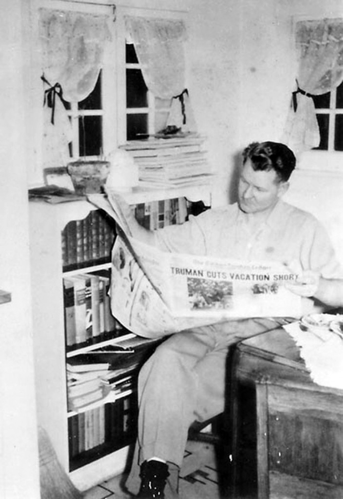 Dad reading the newspaper, probably about 1950, probably in Puyallup, Washington.