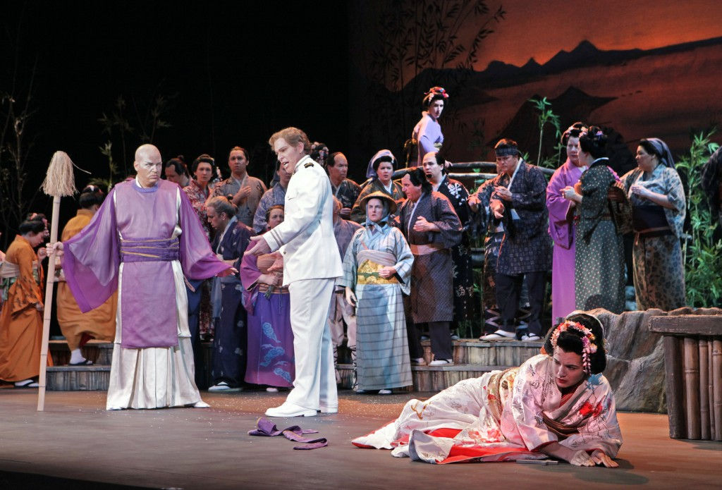 "Kelly Kaduce as Cio-Cio-San in ""Madame Butterfly,"" with Gustav Andreassen (left) as the Bonze and Roger Honeywell as Pinkerton. ©Portland Opera/Cory Weaver."